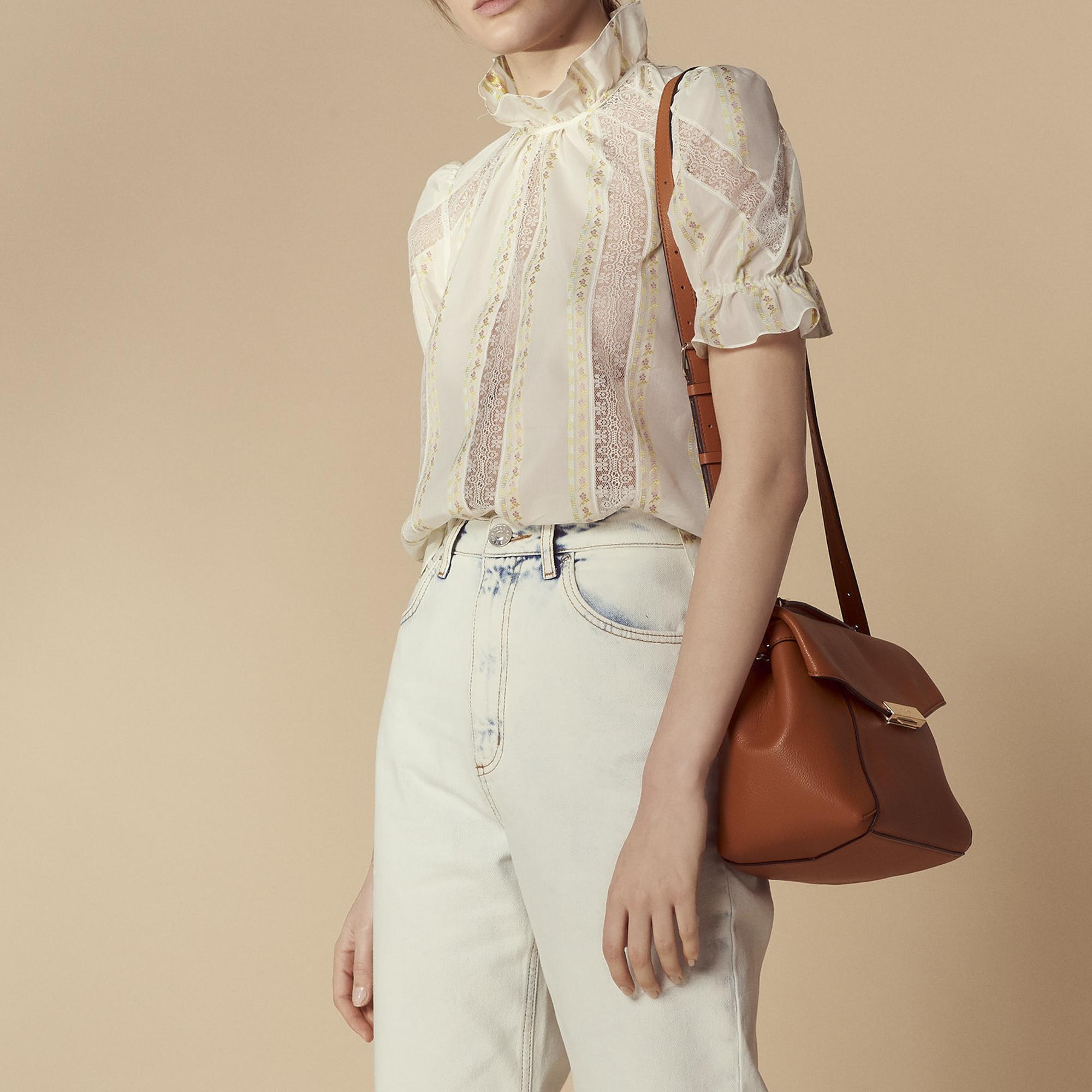 Top a collo alto con maniche a sbuffo : Top & Camicie colore Ecru